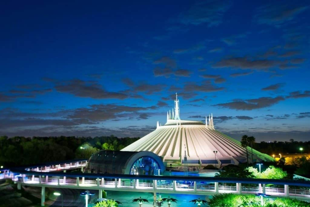 Photo of the exterior of Space Mountain roller coaster at night.