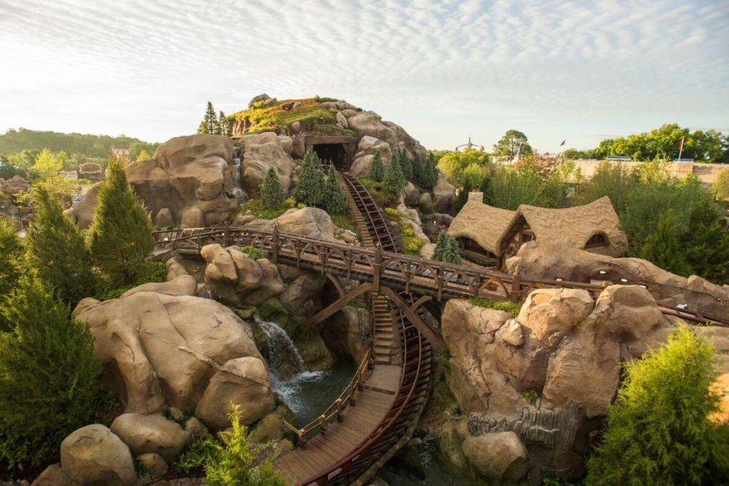 Landscape view of a section of the Seven Dwarfs Mine Train roller coaster at Disney World's Magic Kingdom.