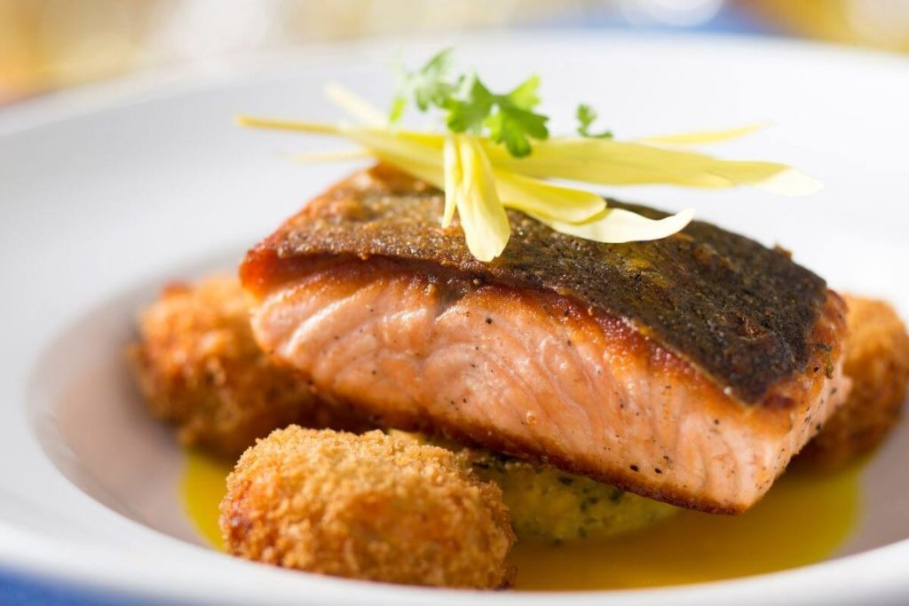 Closeup of a salmon dish from California Grill at Disney World's Contemporary Resort.