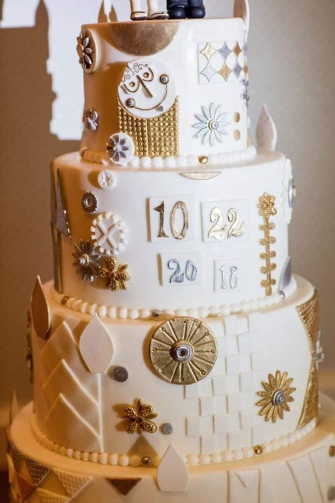 Closeup of a wedding cake with designs inspired by Disney's classic ride, It's a Small World.