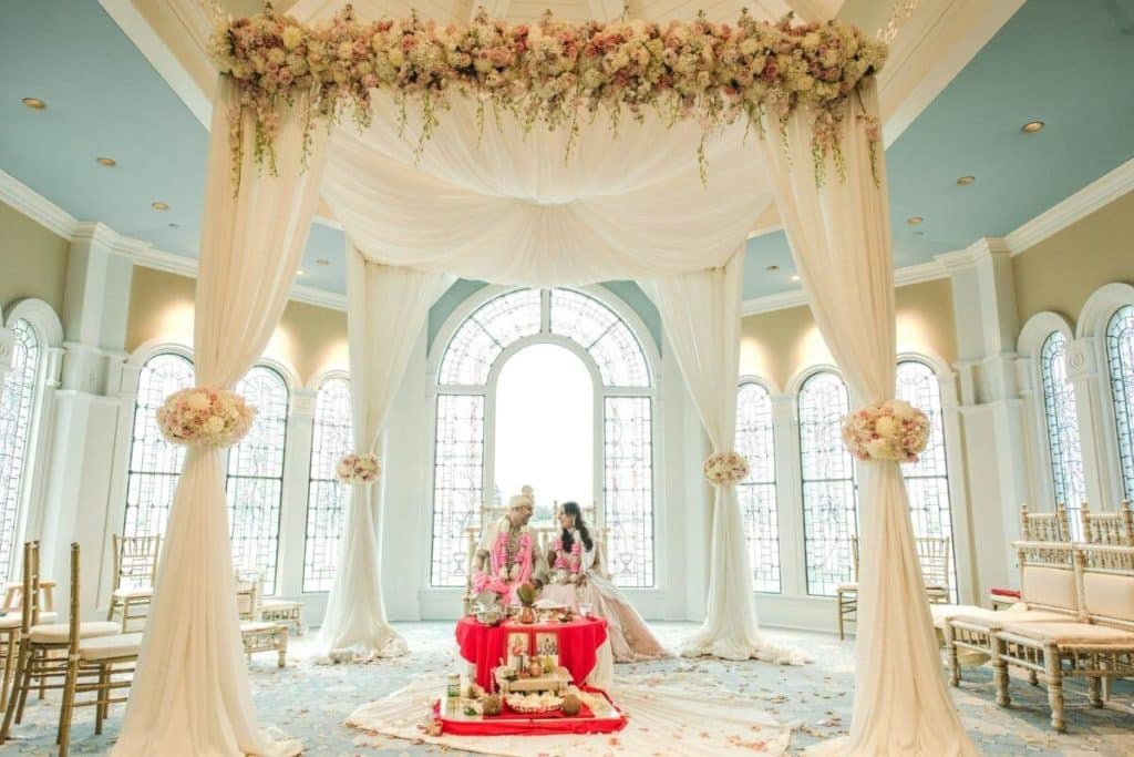 Photo of an Indian couple posing inside the wedding pavilion at the Grand Floridian Resort at Disney World.