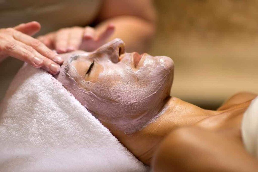 Closeup of a woman getting a facial at a spa.