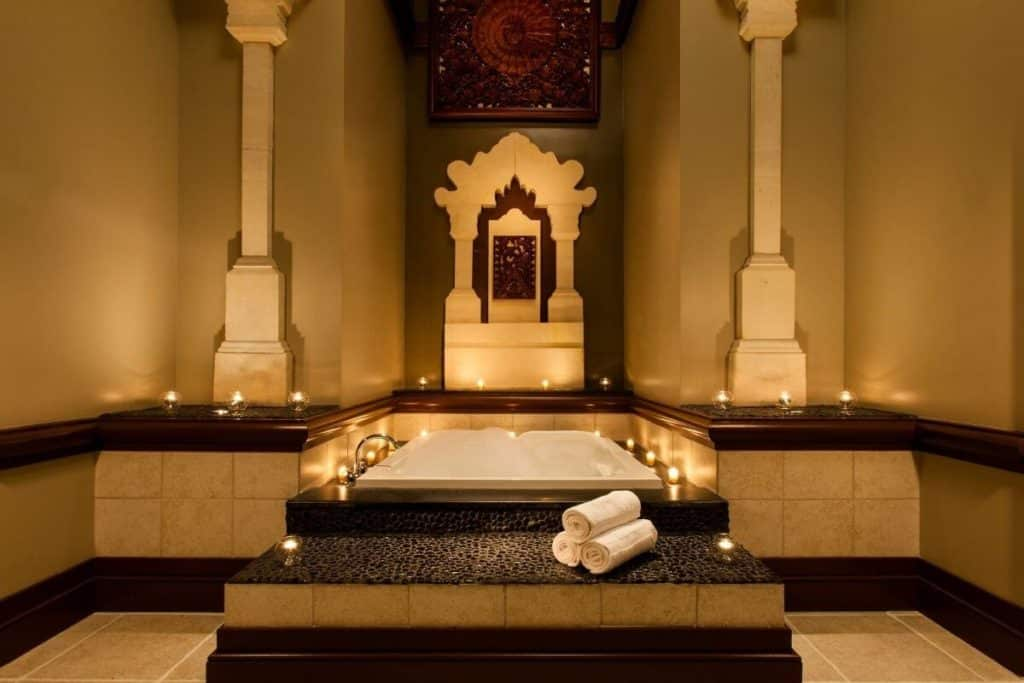 Photo of a candlelit bath at a spa.