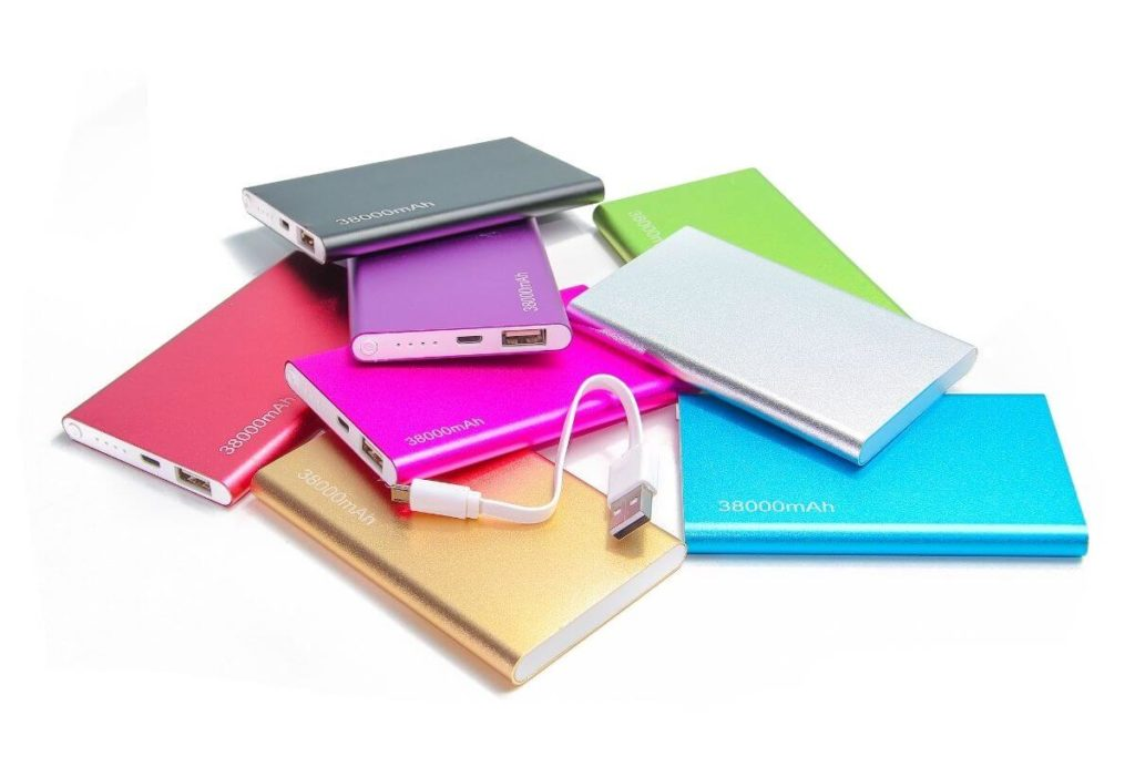 Photo of a pile of colorful rechargeable power banks.