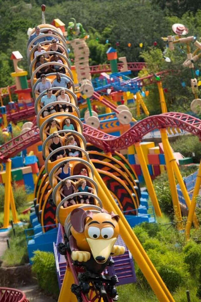 Photo of guests riding Slinky Dog Dash roller coaster at Disney World's Hollywood Studios.