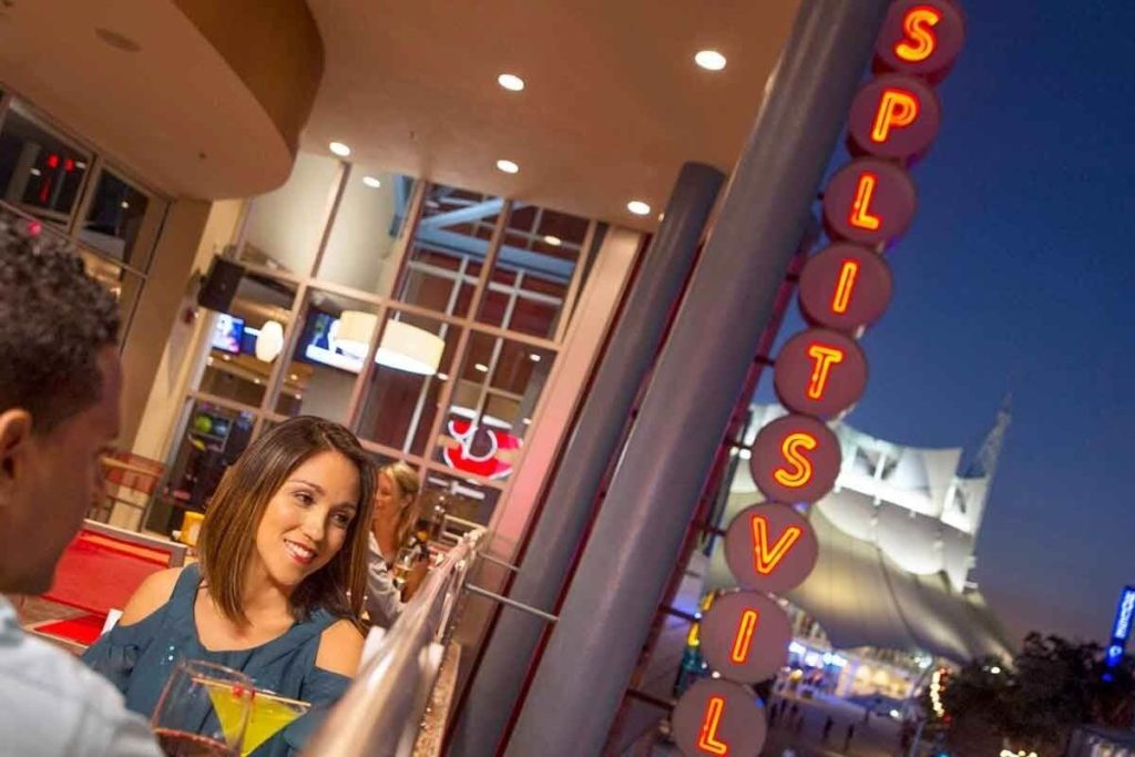 Closeup of a couple dining on the balcony at Splitsville entertainment complex.