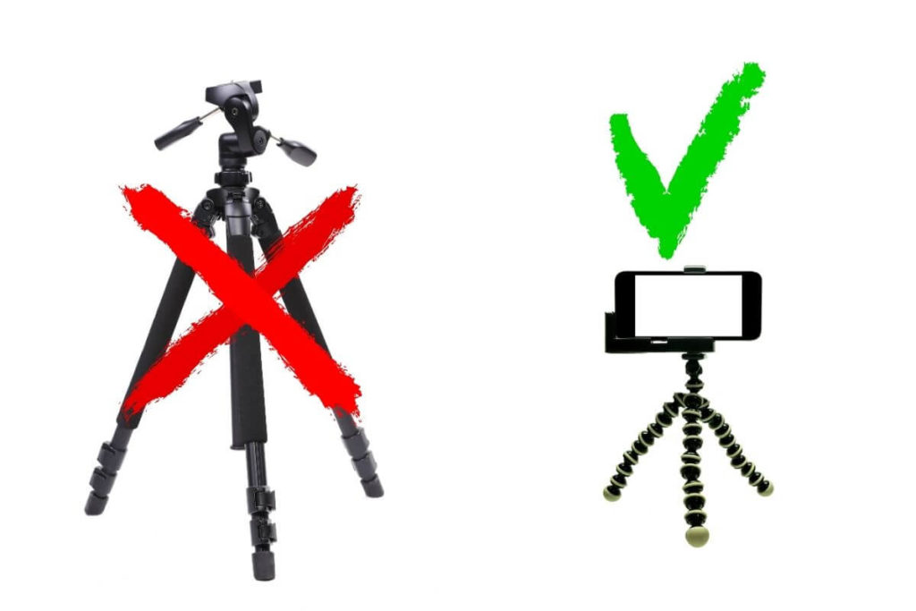 Graphic showing a traditional camera tripod with an X over it and a compact GorillaPod mini tripod with a check mark above it.