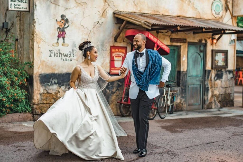 A bride and groom dance in a walkway in Disney World's Animal Kingdom theme park.