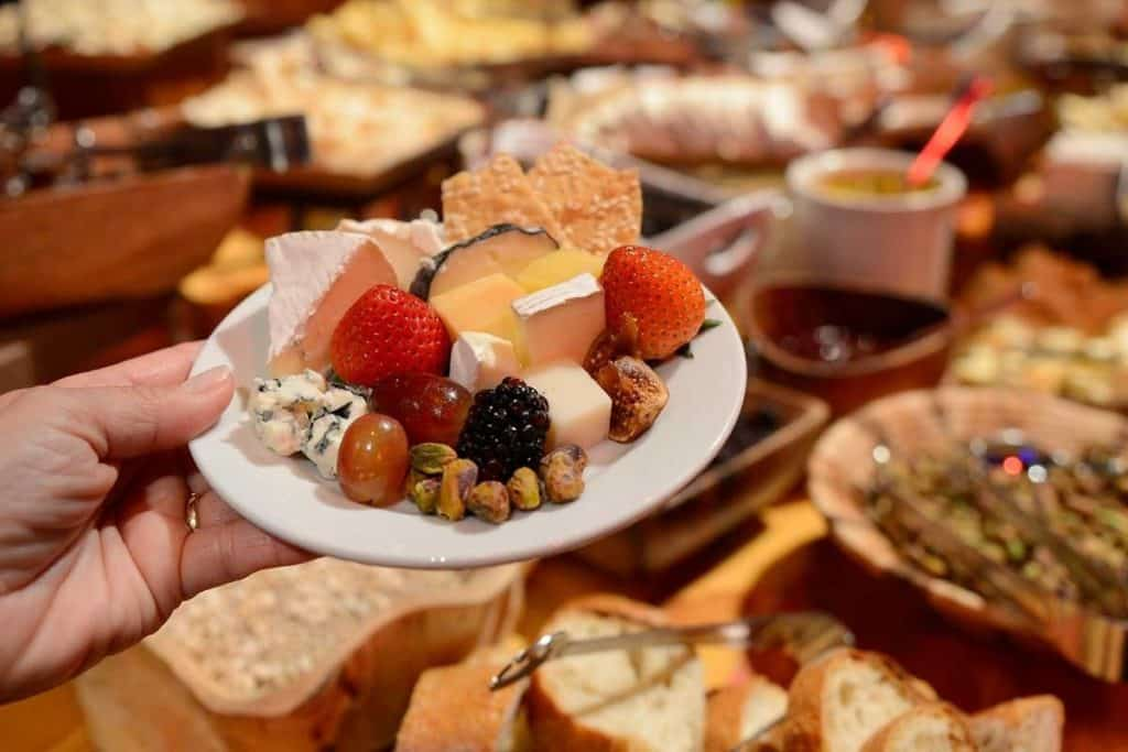 Photo of a plate filled with cheese, fruit, nuts, and crackers at the Epcot Party for the Senses.