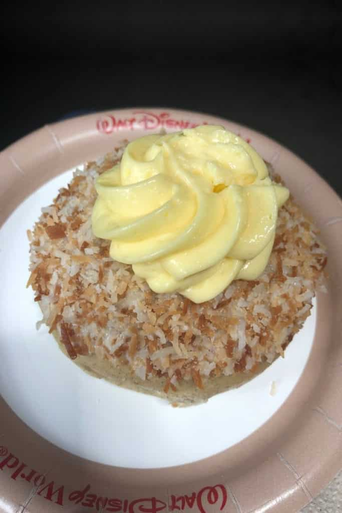 Closeup of Norwegian School Bread topped with custard and toasted coconut.