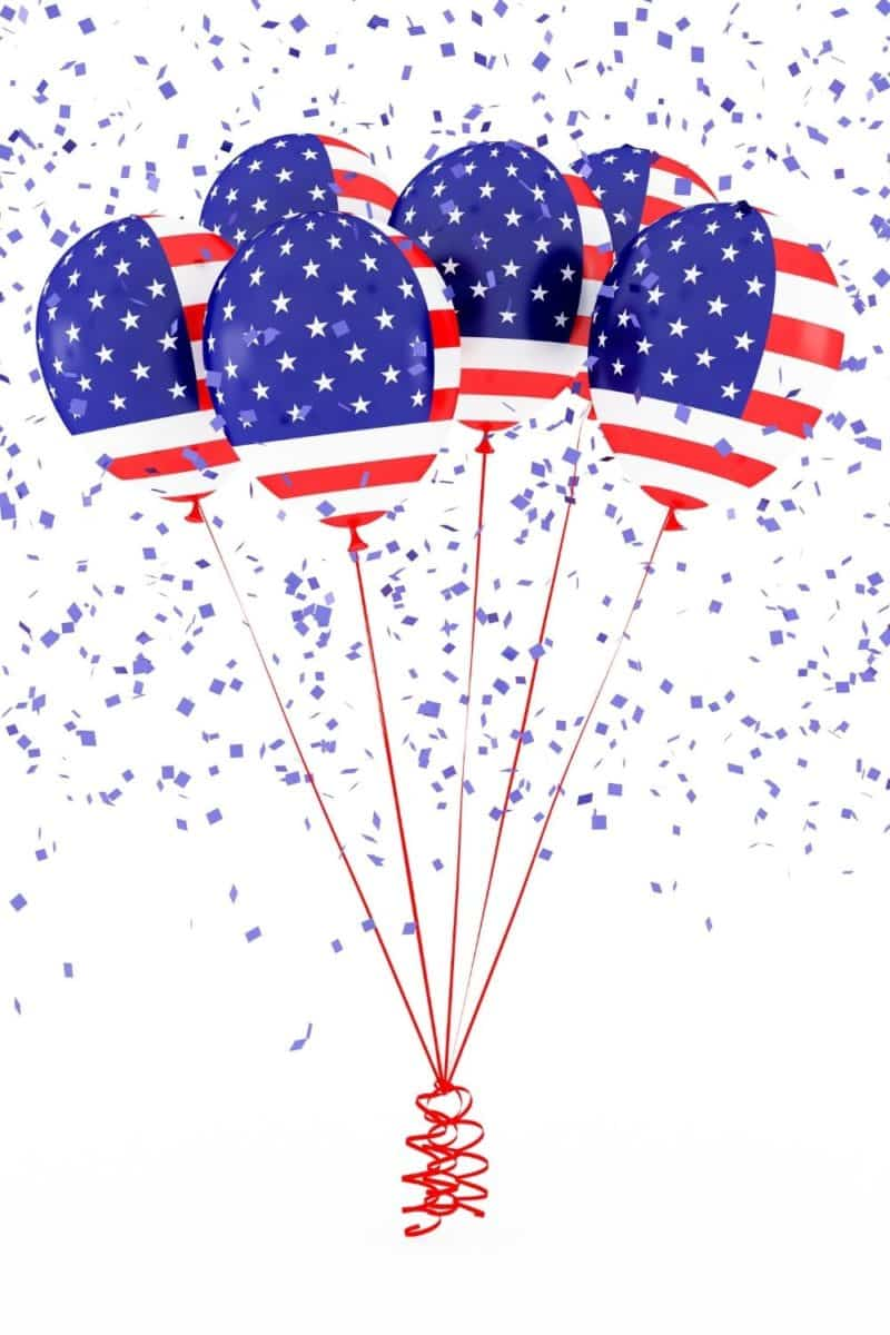 Photo of half a dozen American flag print balloons with red string, plus blue confetti raining down.