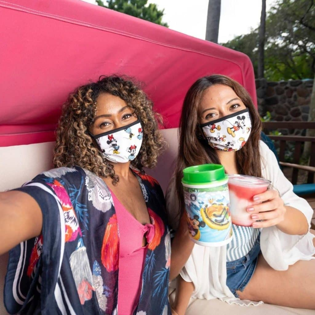 Photo of 2 young women at Disney World's Blizzard Beach, relaxing with frozen drinks.