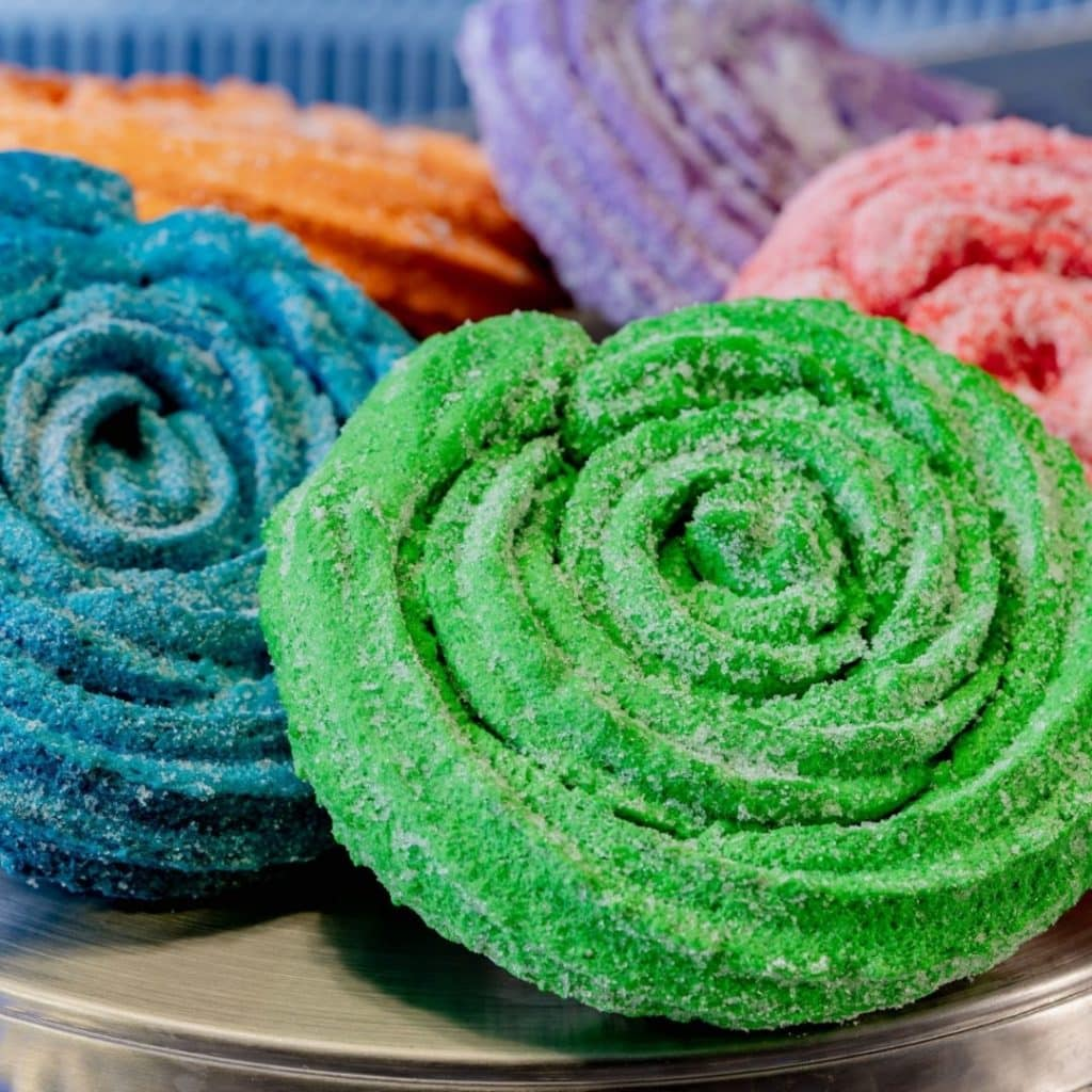 Closeup of brightly colored Sweet Spiral Ration Churros from Terran Treats at the Avengers Campus at Disney California Adventure Park.