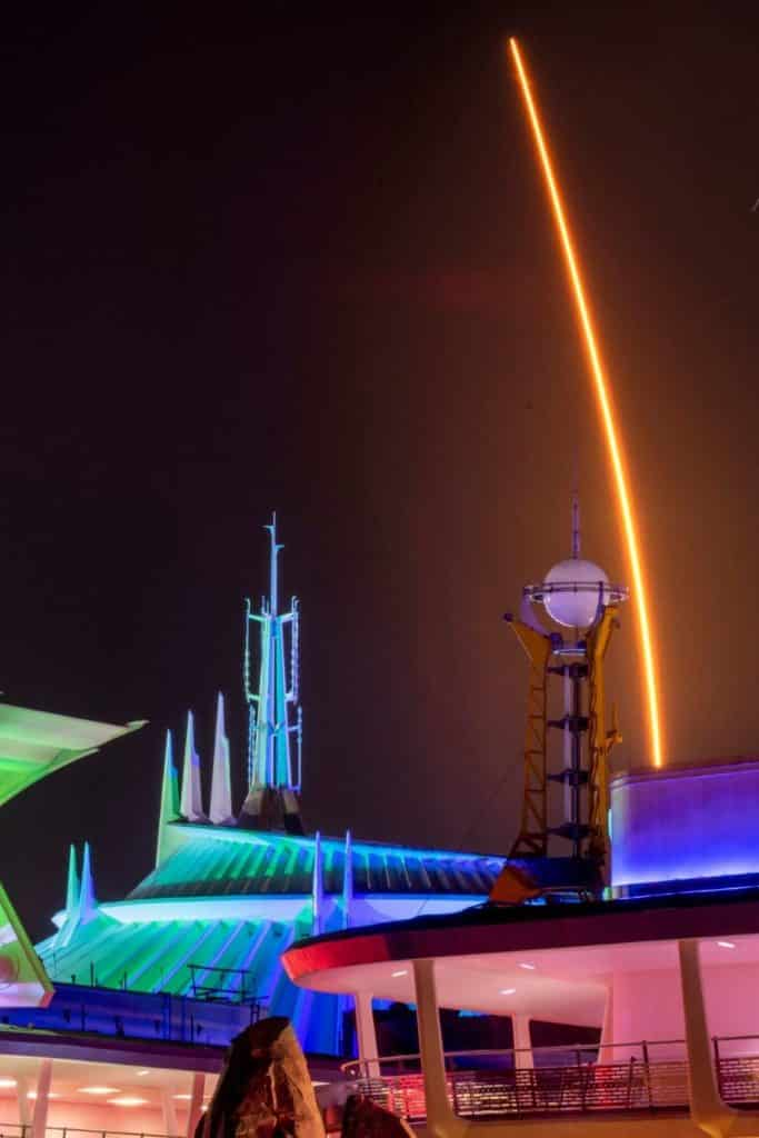 Photo of Tomorrowland at Magic Kingdom at night with lots of neon lights lit up.