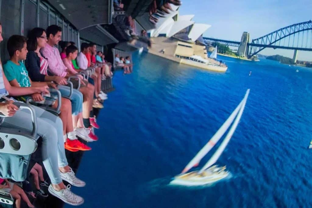Closeup of guests riding Soarin Around the World at Epcot.
