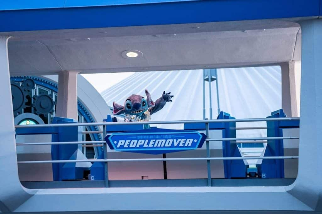 Photo of Stitch riding the PeopleMover ride at Magic Kingdom.