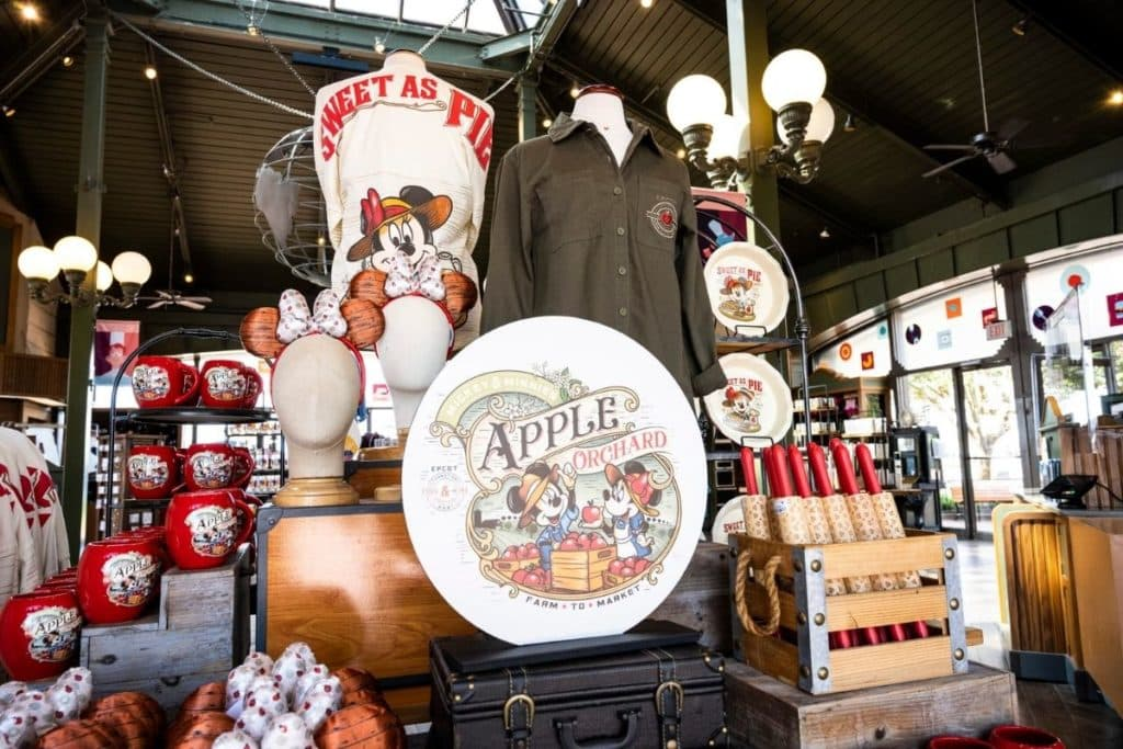 Photograph of an Epcot Food & Wine merchandise display, including Epcot Food & Wine shirts, mugs, rolling pins, ears, and more.