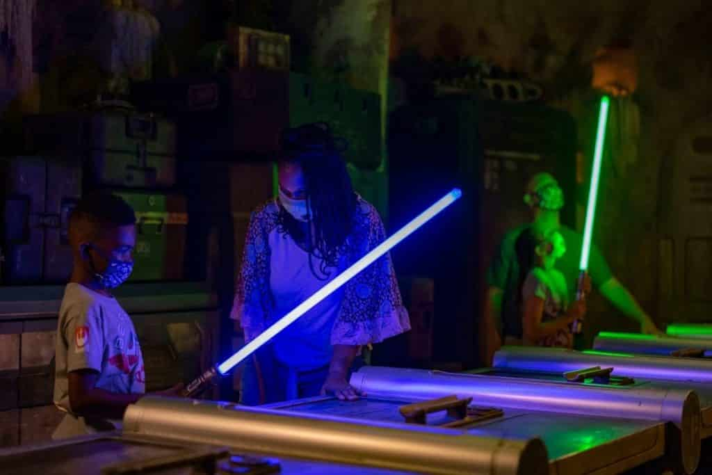 Photo of people making a light saber at Disney's Hollywood Studios.